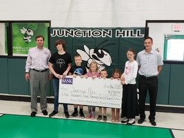 Students accept donation from West Plains Bank